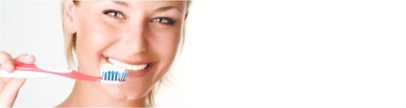 Smiling women holding thoothbrush