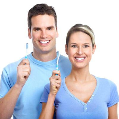 couple with toothbrushes